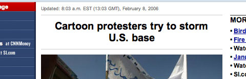 A screen capture of a CNN headline, which reads: Cartoon protesters try to storm U.S. base.