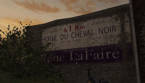 A French painted sign on a wall at sunset with inaccurate fonts.