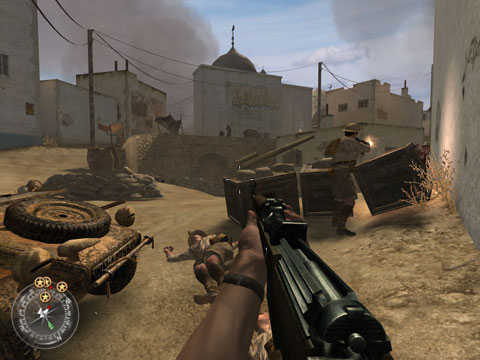 British soliders fire on German positions in a dusty North African town.