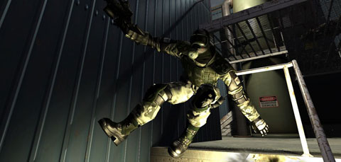 A clone troop leaps over a handrail off a raised level, lit by muzzle flare.