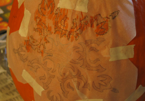 My pumpkin design on tracing paper, part-way through the punching process.
