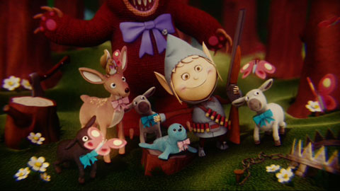 Bright, happy claymation elves and forest creatures gather together singing. The elf has a shotgun and ammo belt on.