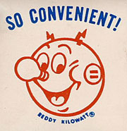 The head of Reddy Kilowatt, mascot for electricity smiles underneath blue condensed sans serif letters reading 'SO CONVENIENT!.