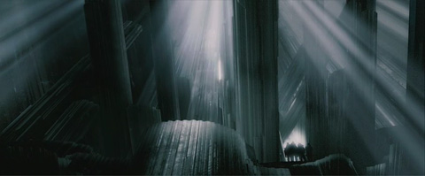 An interior shot of the fortress of solitude, dark, striated crystal columns angle to create a cavern that allows in shafts of light.