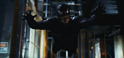 Venom leaps towards the viewer, arms out, fangs bared.