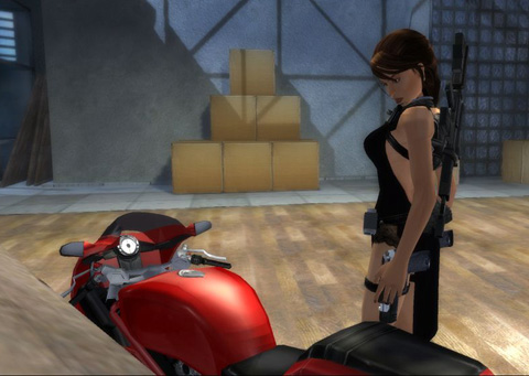 Lara looks down at a red motorcycle in a lit storage room at night.